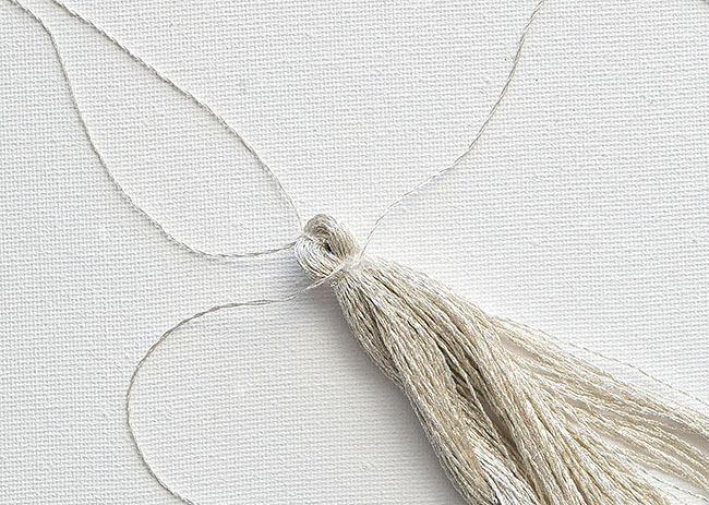 silver embroidery thread tassel