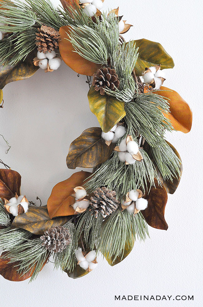 magnolia wreath with frosted evergreen sprigs