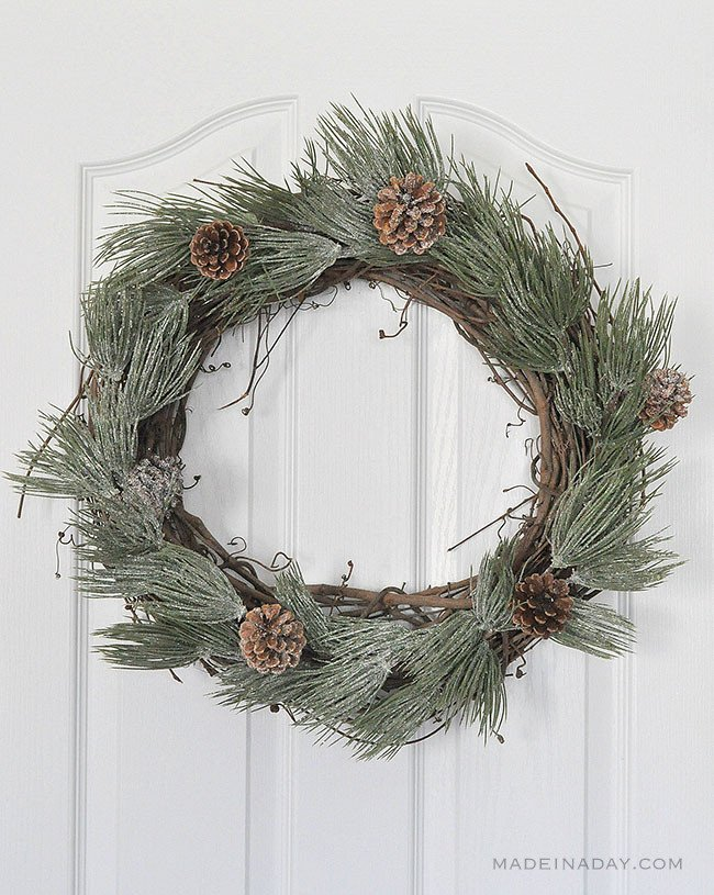 add frosted sprigs to grapevine wreath