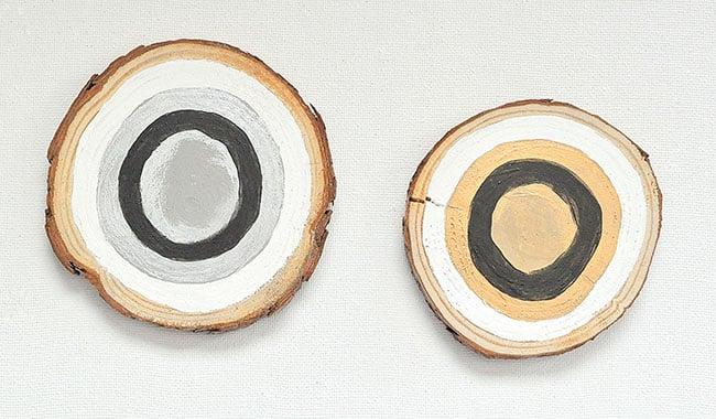paint bullseye on wood slice