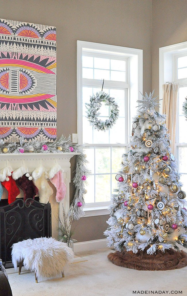 It's a White, Pink, Black and Brown Boho Flocked Christmas Tree this year + a Christmas Tree Blog Hop! Pink ornaments, Feather ornaments, how to decorate a flocked tree #bohemian #Christmastreedecor,