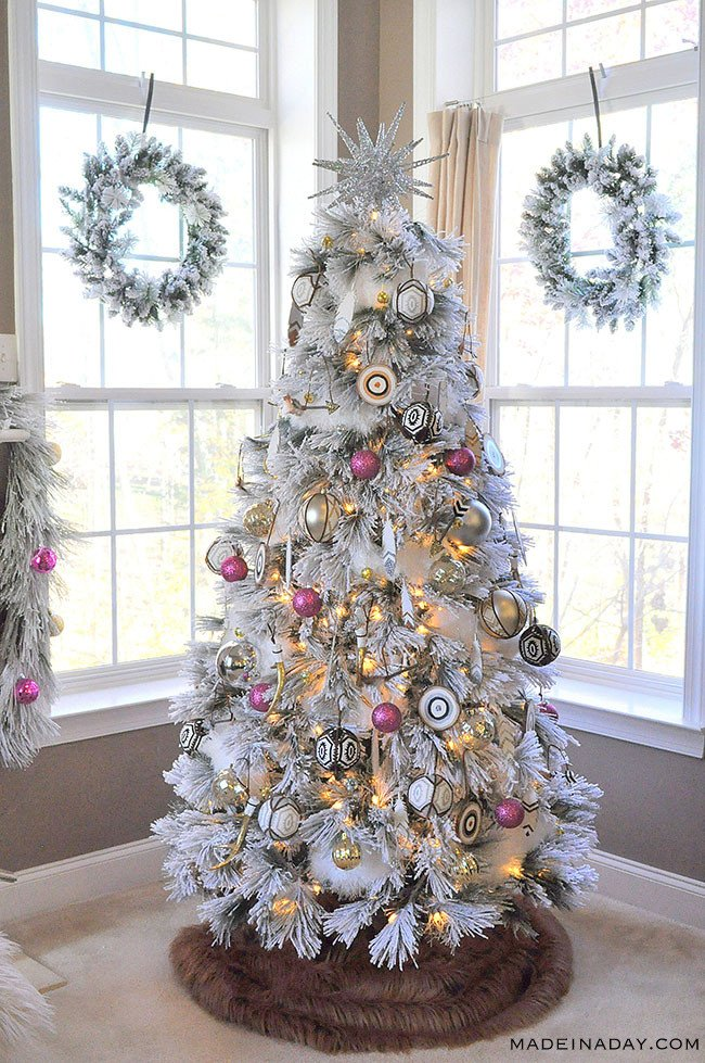 It's a White, Pink, Black and Brown Boho Flocked Christmas Tree this year + a Christmas Tree Blog Hop! Pink ornaments, Feather ornaments, how to decorate a flocked tree, bullseye ornament, #Christmastreedecor,
