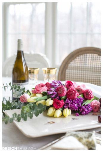 wine and cheese table with flowers