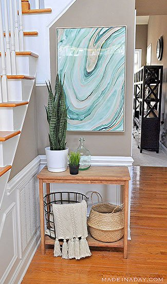 Green Entryway with High Gloss Agate Wall Art Snake Plant Baskets-2