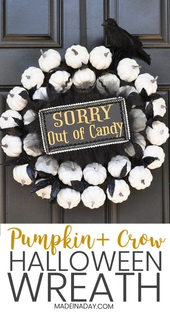 white pumpkin halloween wreath, sorry out of candy sign,