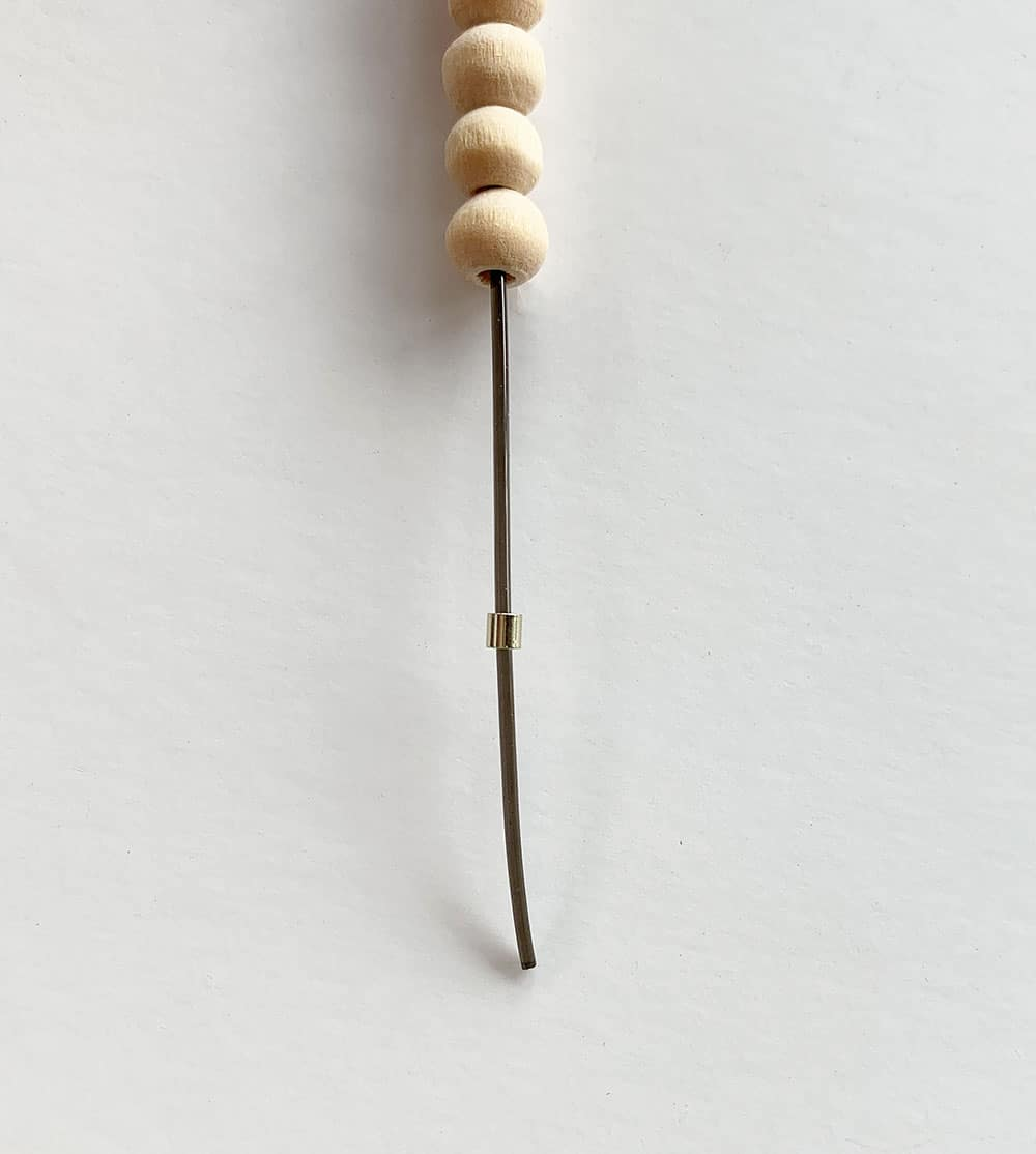 Adding a crimp bead on a cord for bracelet
