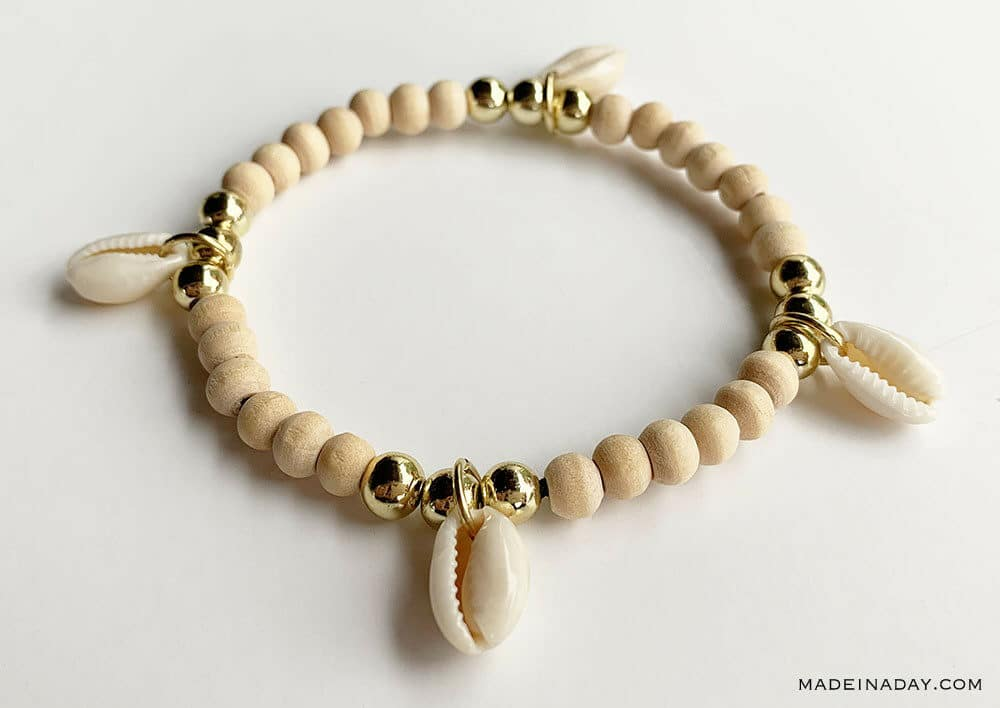 four charm cowrie shell bracelet