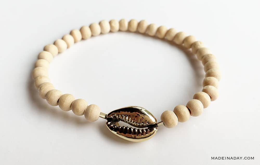 wood bead bracelet with gold cowrie shell, cowrie shell bracelet, Puka bracelet
