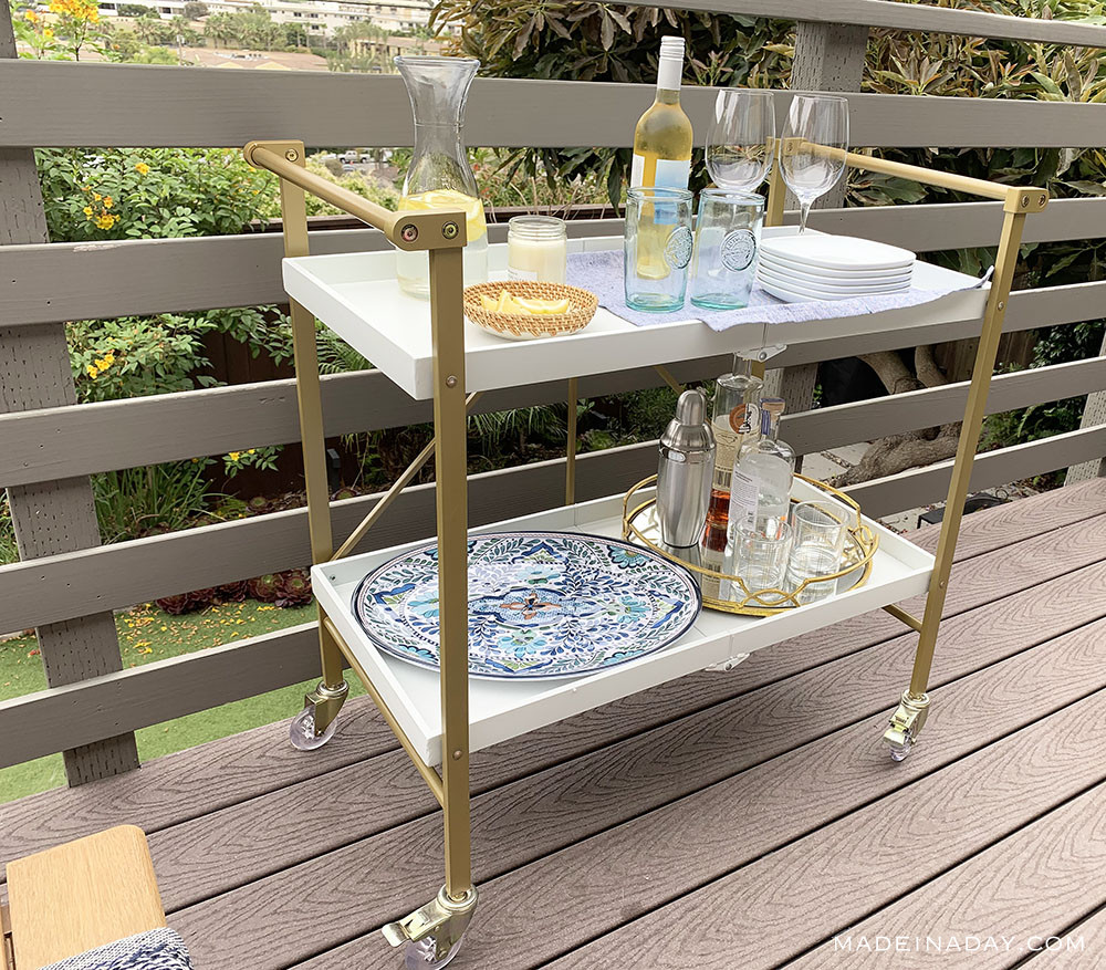 foldable gold and acrylic bar cart