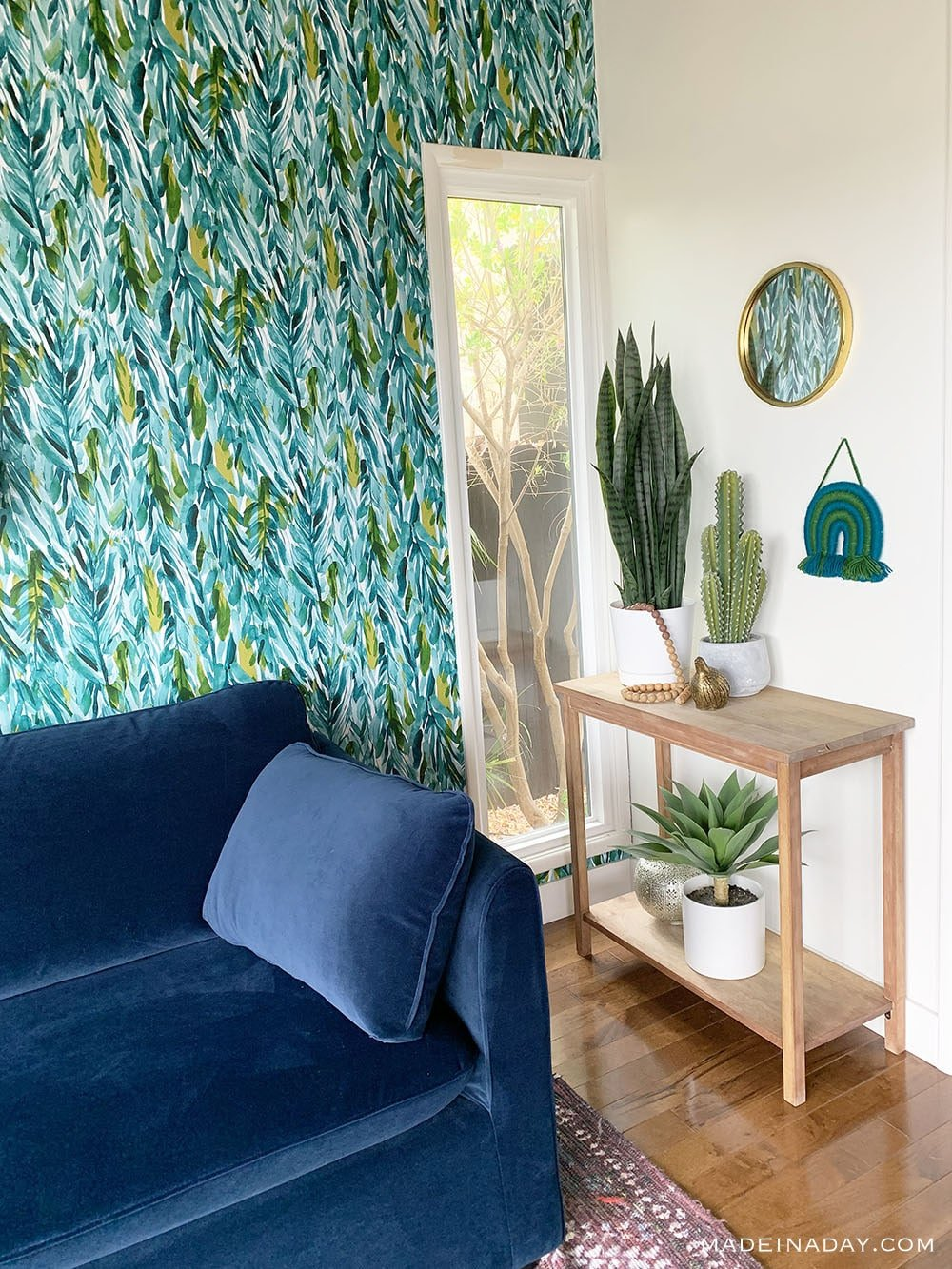 jungle arms wallpaper, blue velvet sofa, bungalow small space guest room,
