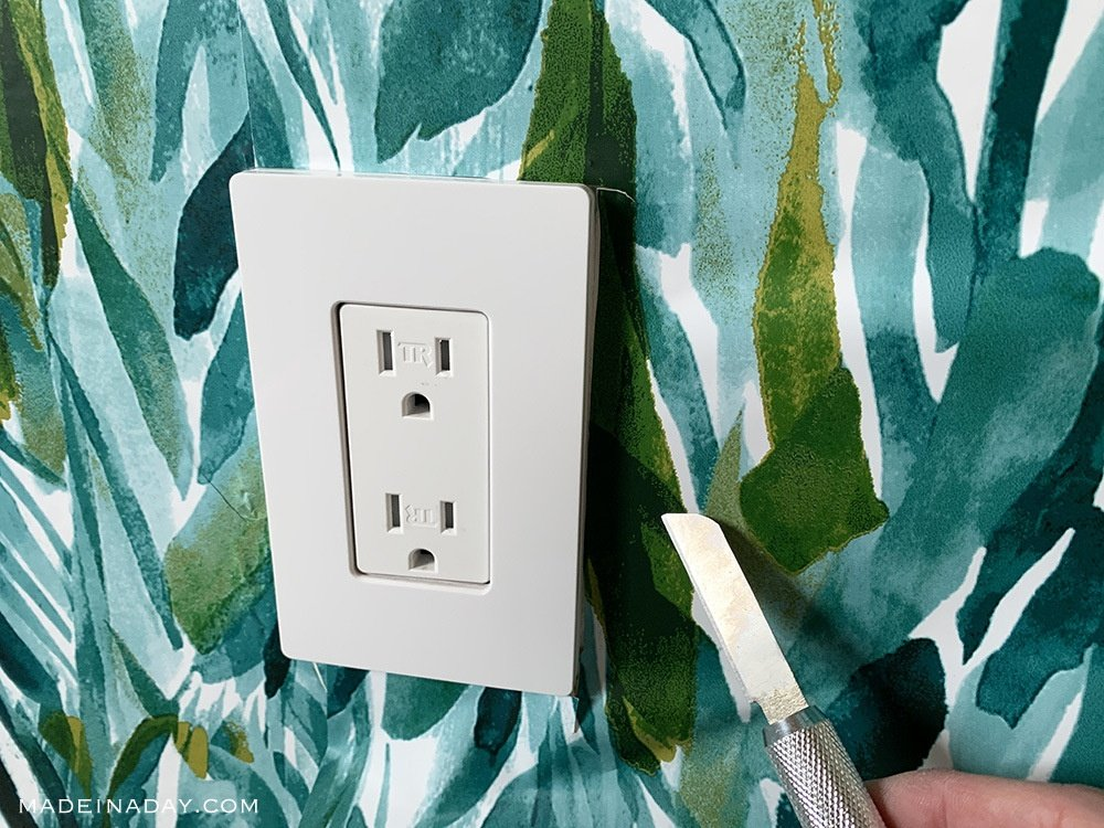 Trim wallpaper around outlets