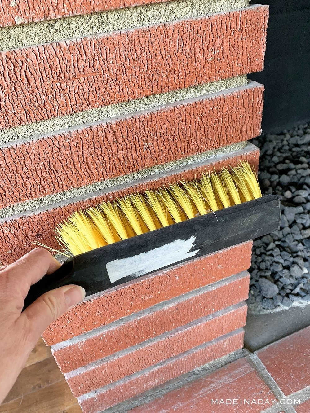 Clean fireplace with stiff brush, how to paint a fireplace, clean bricks with brush