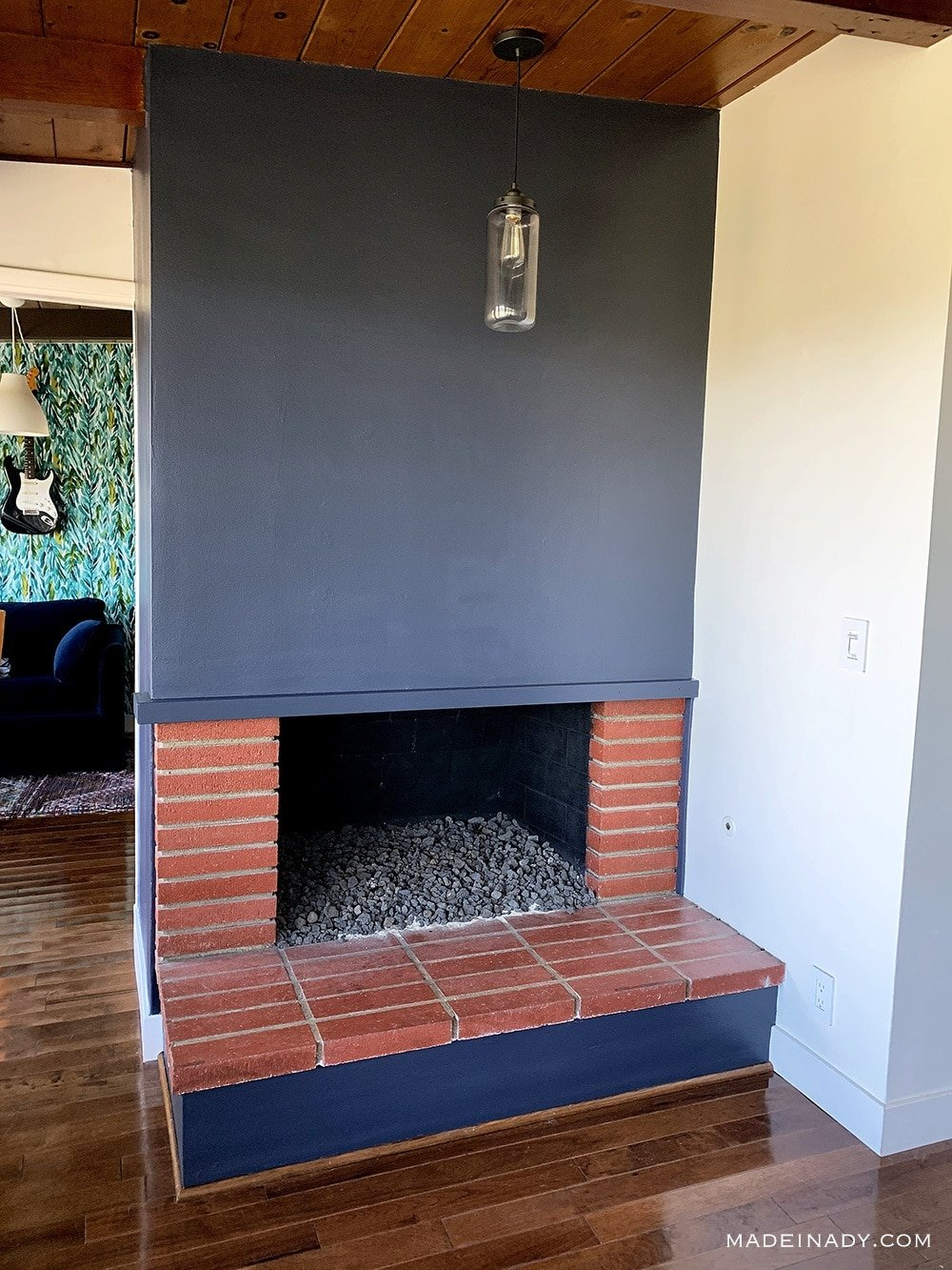 grey painted fireplace red bricks, grey wall red brick fireplace, red brick fireplace accent wall