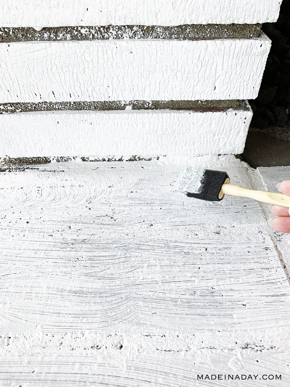 Use a craft sponge applicator to put primer on bricks, How to paint a fireplace