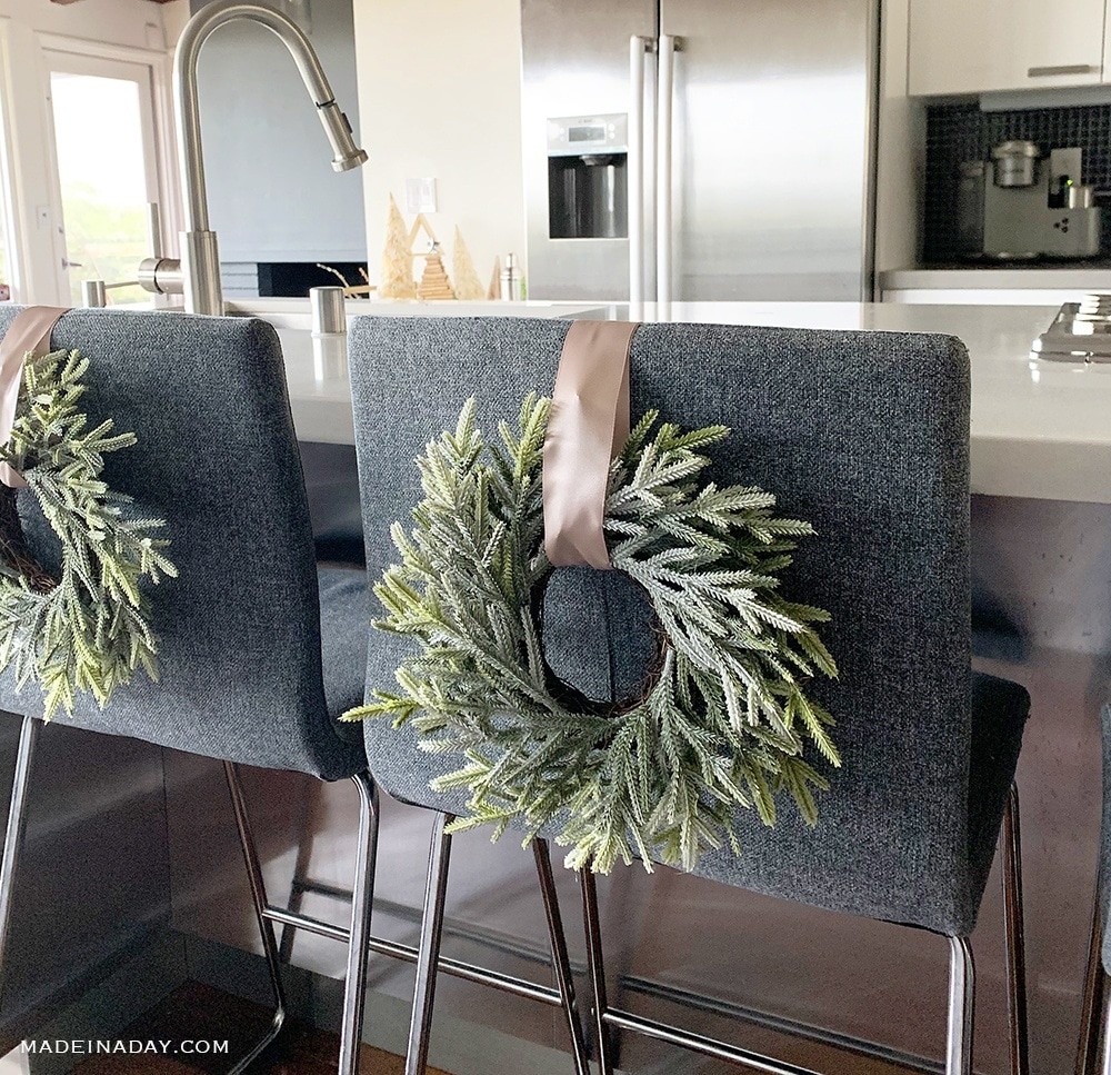 Christmas Wreath on Barr Stools. Christmas Wreaths on chairs