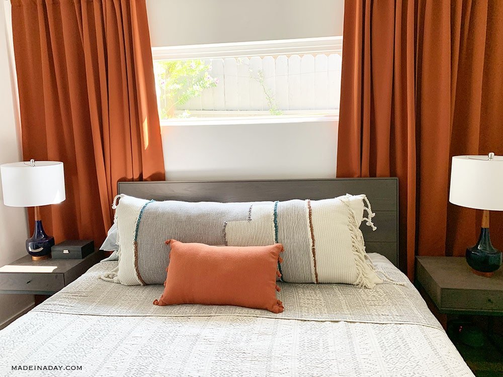 rust bedroom, blaze orange bedroom, Tribal Coverlet bedding, DIY ovesrized lumbar pillow, global bedroom, modern boho