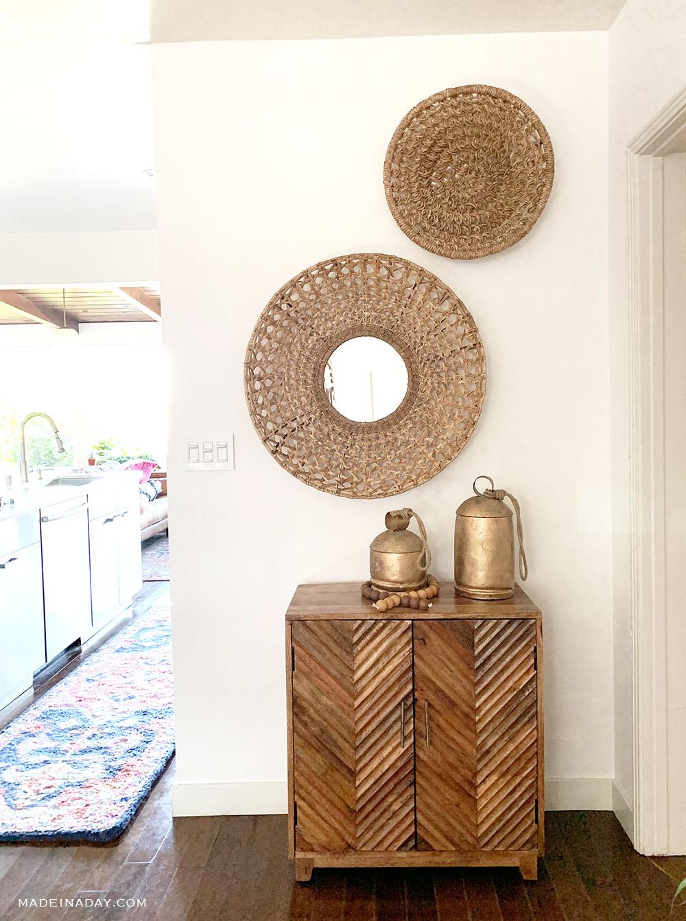 round basket wall art, round basket mirror wall art, wood chevron cabinet, large gold metal bells, punjab temple bells, Amerita Rug Anthropologie, large harmony bells