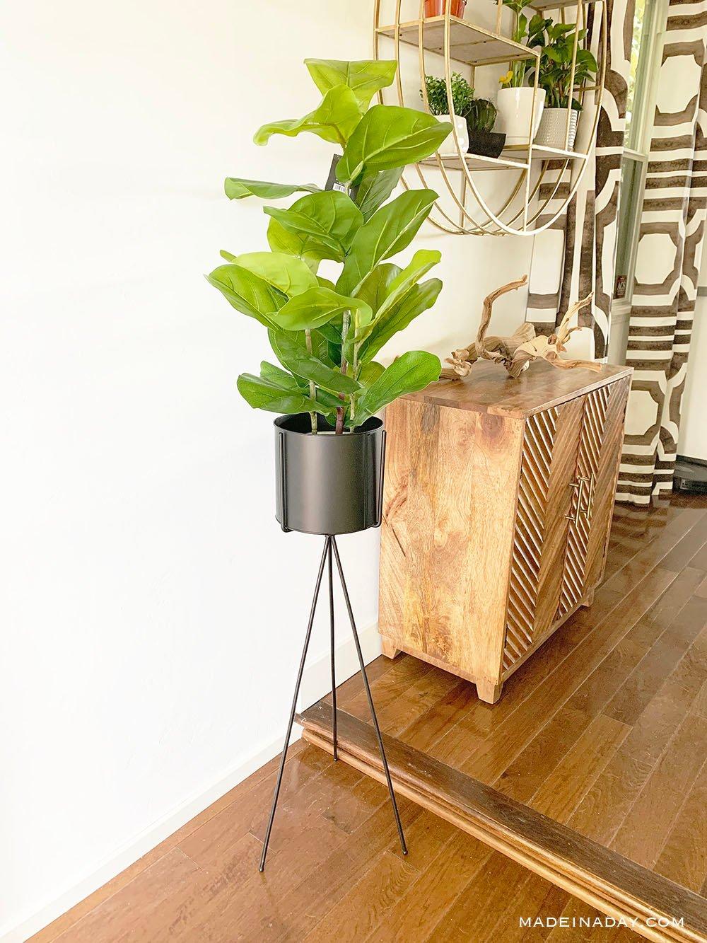modern black tripod planter, best faux fiddle leaf fig tree plant, chevron wood cabinet, California drift wood, gold round shelf, mecca curtain