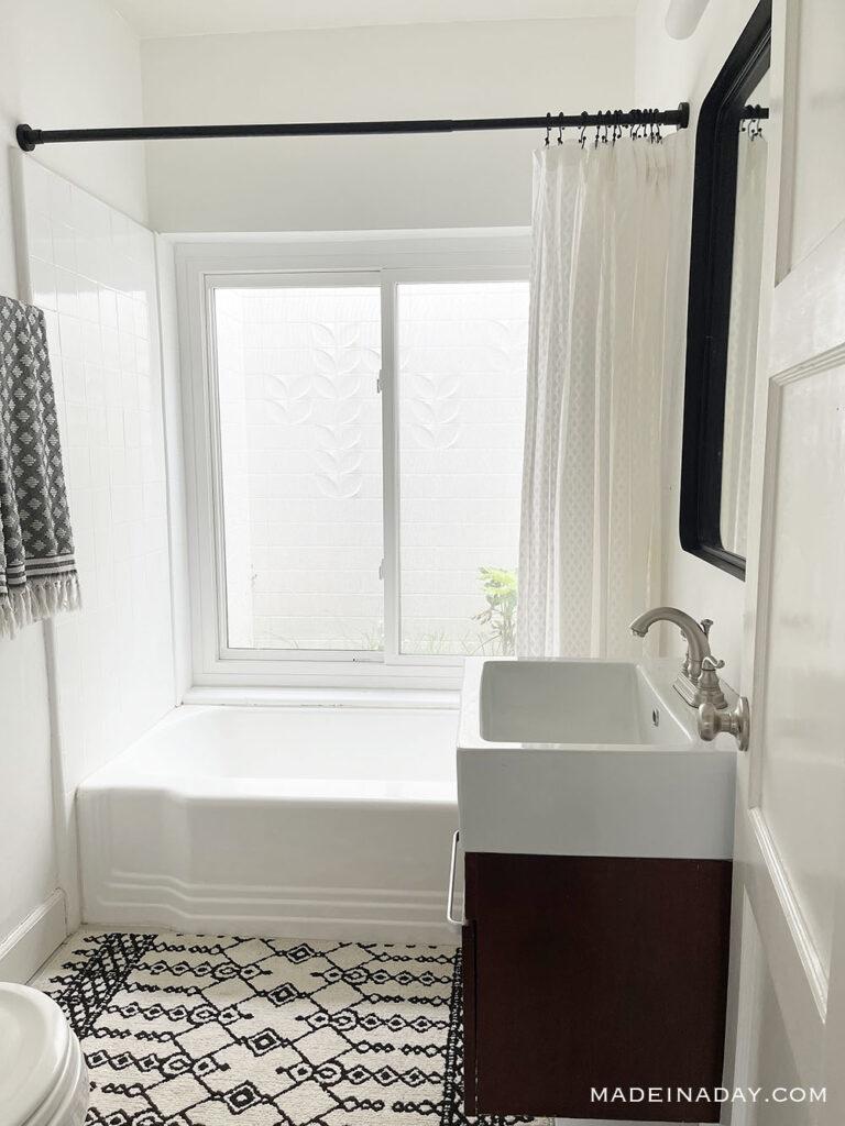 black white bathroom with atrium