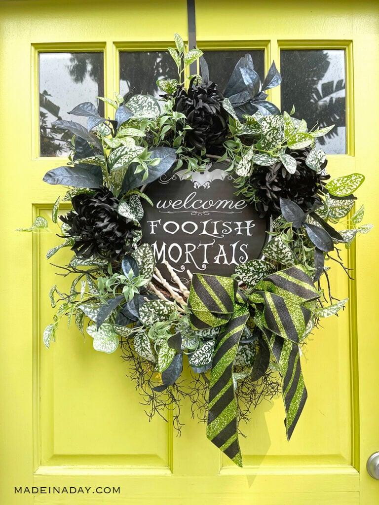 Haunted mansion wreath on green door