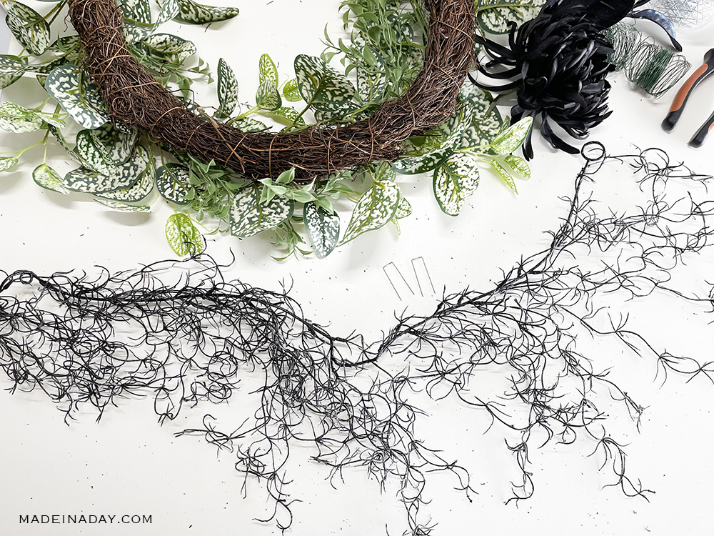 add the moss garland to the edge of the wreath